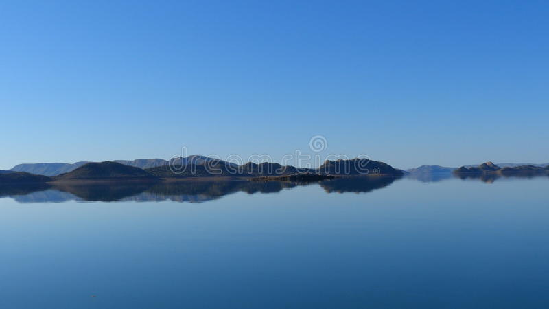 Reflections Lake Argyle Western Australia. Lake Argyle Western Australia is the second largest man made lake in the Australia. The Ord River was dammed in 1963 stock photography