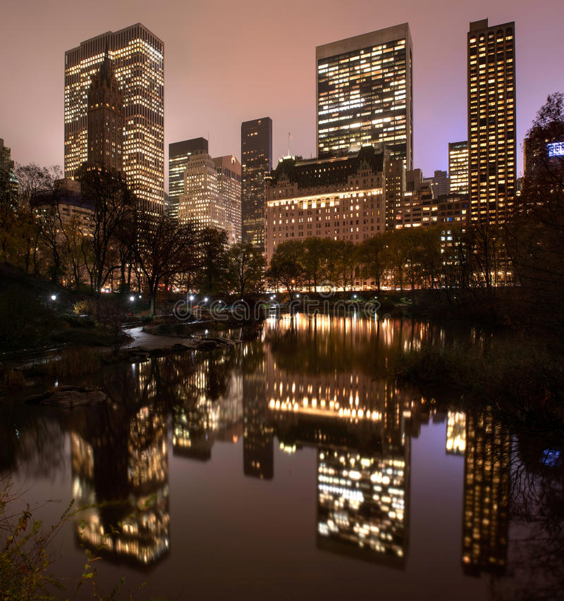 Reflections of Manhattan in Central Park pond at night. Part of the Manhattan Skyline reflected in a pond in Central Park at night royalty free stock photography