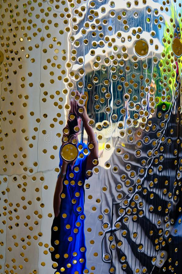 Reflections in a Modern Metal Sculpture Covered in Small Holes, Sydney, Australia stock photos