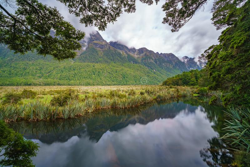 Reflections of mountains in the mirror lakes, new zealand 29. Reflections of mountains in the mirror lakes, southland, new zealand royalty free stock photography