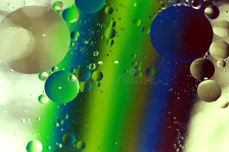 Reflections in oil stock images