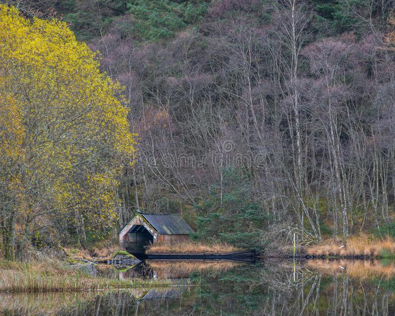 Reflections of an Old Boathouse on Loch Chon, Scotland royalty free stock image