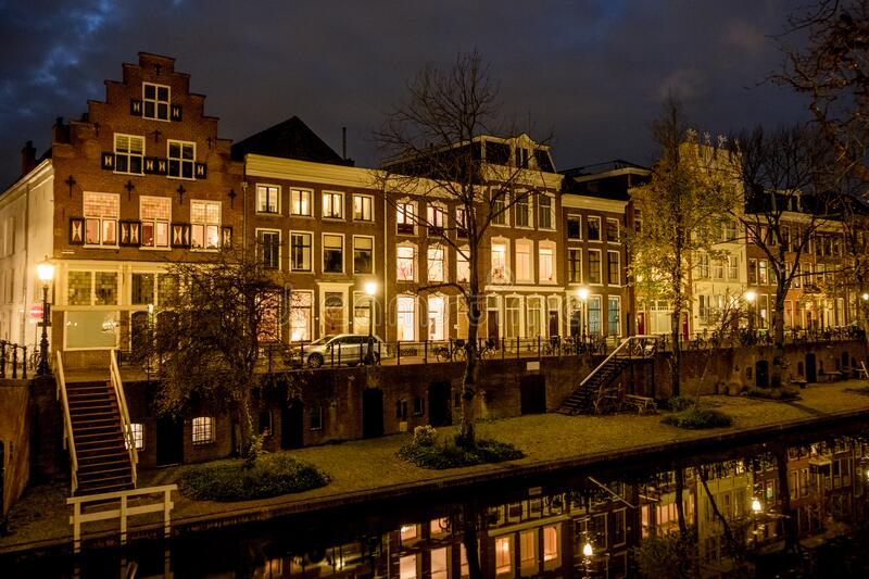 Utrecht Oudegracht Canal Houses at Night. Reflections on the Oudegracht Canal in Utrecht with diverse canal houses stock photos