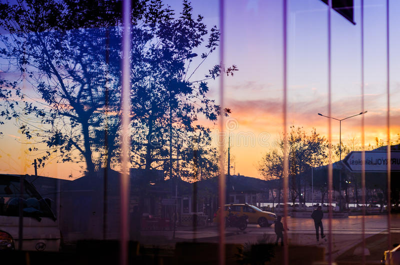 Reflections On Restaurant Window. Reflections of a street next to the shoreline in the glass windows of a local restaurant in Cinarcik town of Turkey. Cinarcik royalty free stock image