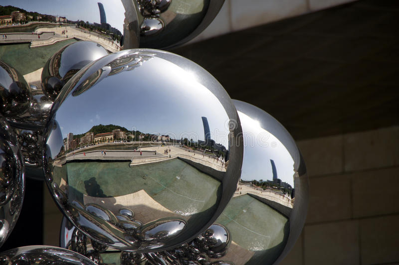 Reflections in sculpture Guggenheim museum in Bilbao royalty free stock photo