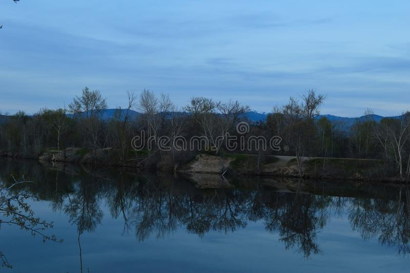 Download Reflections Of Shore On Lake On A Blue Day! Stock Image - Image of idaho, brightened: 100820853