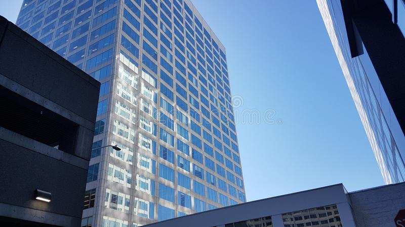 reflections from tall buildings in urban environment large city people royalty free stock images