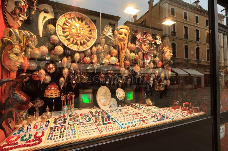 Reflections of the tourists on the windows of the Venetian carnival mask shops in Venice, Italy. Venice, February 2017: Reflections of the tourists on the royalty free stock images