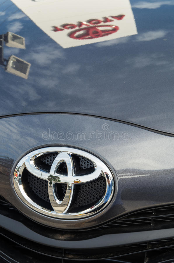 Reflections in a Toyota. A Toyota dealer's sign is reflected in the Bonnet of a Toyota. Toyota is the best selling car brand in Australia royalty free stock photos