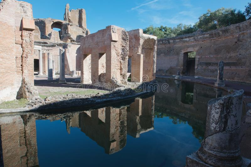 Reflections of the Villa of the Island at Hadrians Villa. The Villa of the Island is a unique and one of the best known structures at Hadrians Villa. A moat stock photo