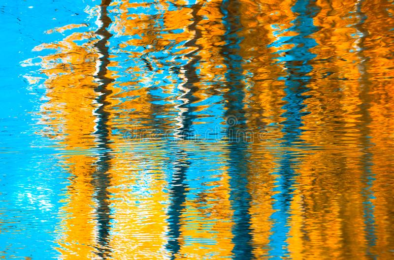 Reflections in the water, abstract autumn background royalty free stock photography