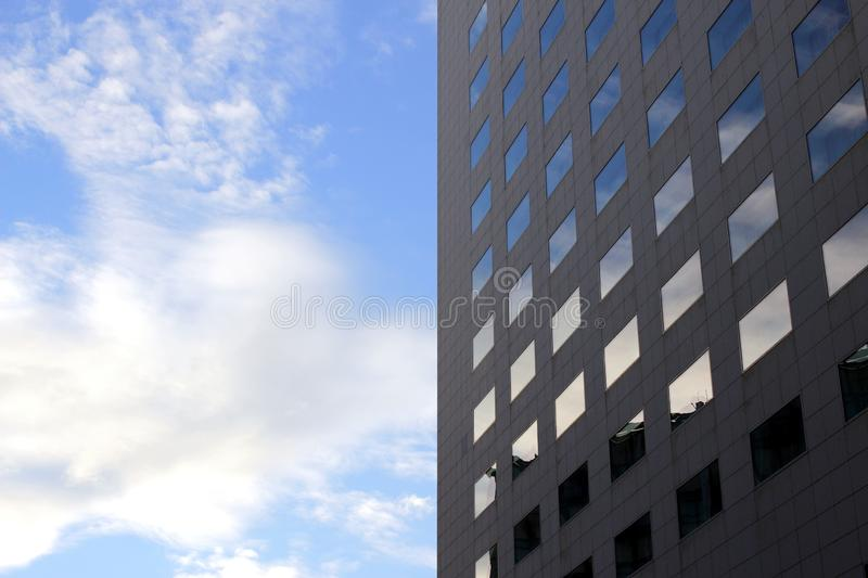 Reflections in windows against the blue sky . stock image