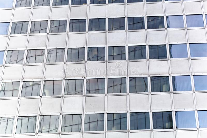 Reflections in the windows of a business skyscraper stock images