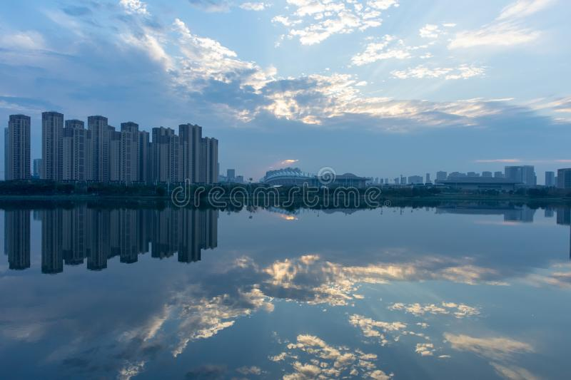 A reflective evening shot of trees and buildings. In Wuhan, China on an unusually low pollution day stock image