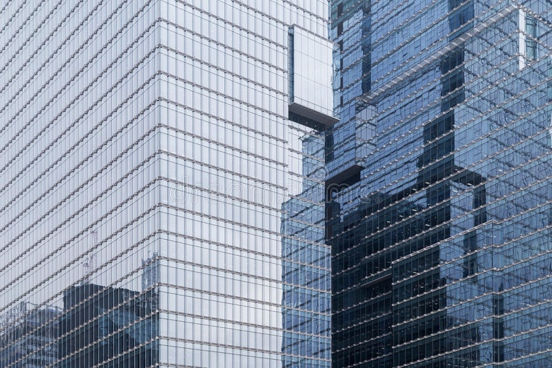 Reflective glassy walls on office buildings. Skyscrapers reflective glassy walls and reflections of another buildings on them in Seoul, South Korea stock photo