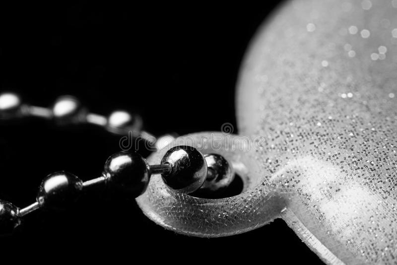 Reflective keychain with a silver ball chain, macro. Part of reflective keychain with a silver ball chain, macro royalty free stock image