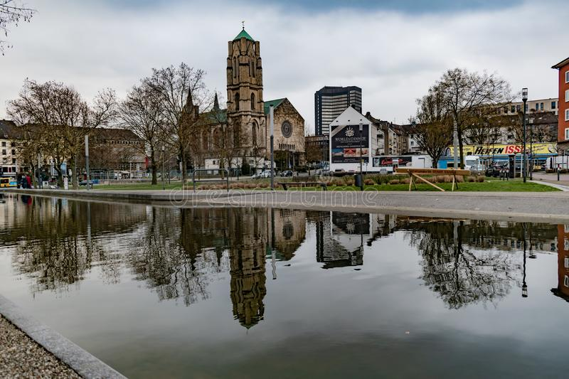 Overview of church and business in the park royalty free stock image
