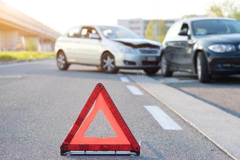 Reflective red triangle to point out car crash stock photos