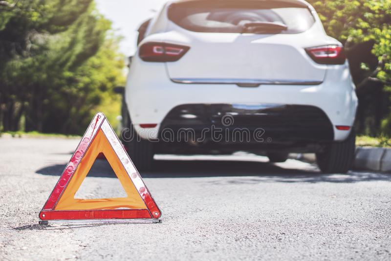 Reflective red triangle to point out a car crash royalty free stock images