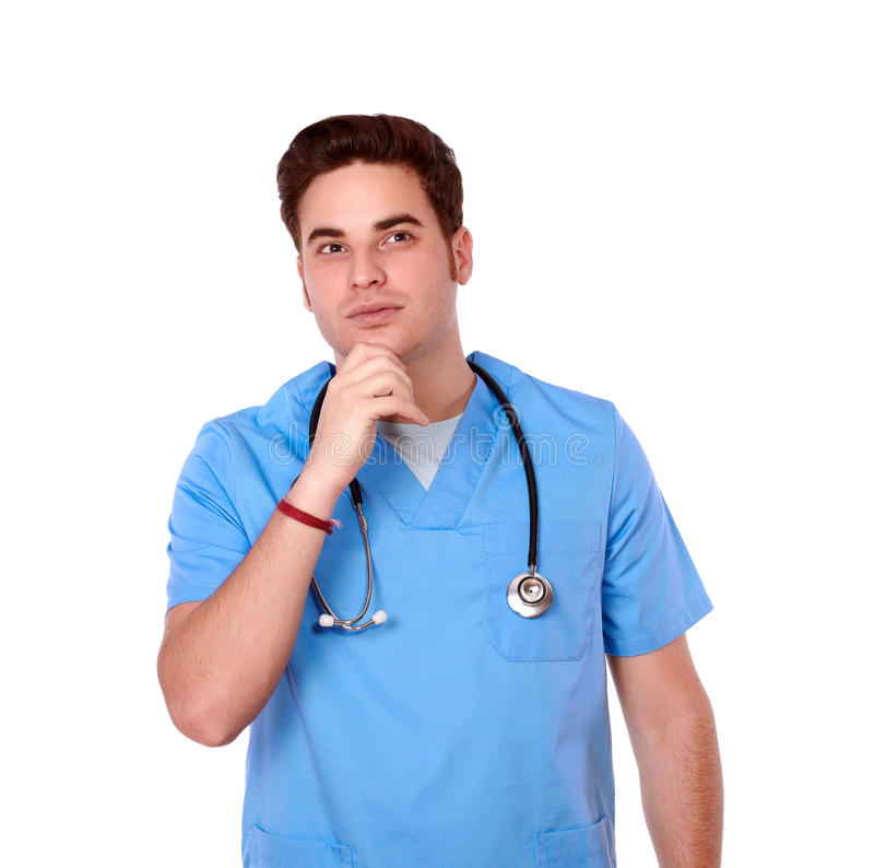 Reflective redhead nurse man looking at people. Portrait of a reflective redhead nurse man on blue medical uniform looking at people while standing on isolated royalty free stock image