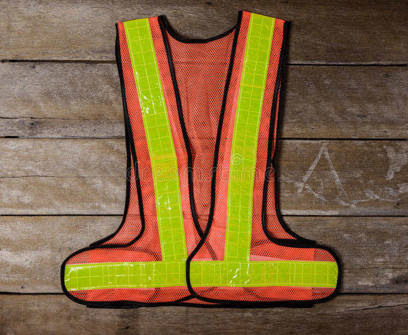 Reflective safety vest Standard safety equipment. On wooden table. top view stock photos