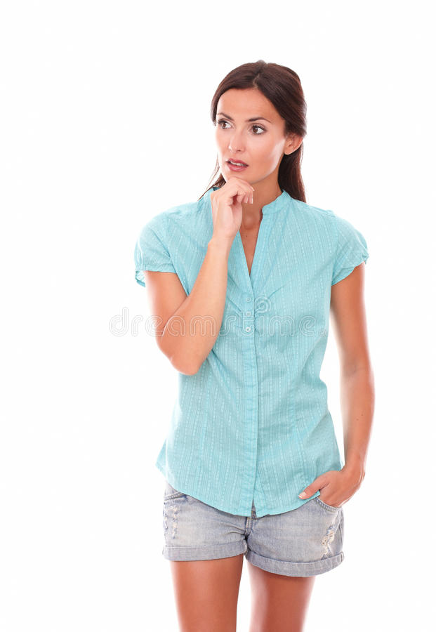 Reflective woman in shorts looking to her right stock photos