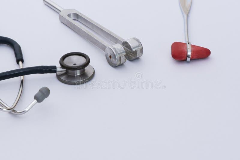 A reflex hammer, tuning fork, stethoscope on white background stock photos