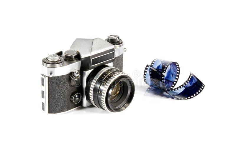 Reflex photo camera and film. Old reflex photo camera on white background and film stock photo