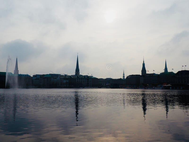 Reflexion av torn i sjön royaltyfri foto