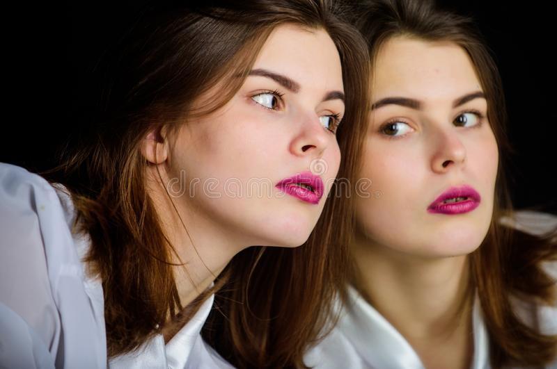 Reflexion girl looking in mirror. Appearance concept. Beauty treatment and skin care concept. Woman makeup face pink stock images