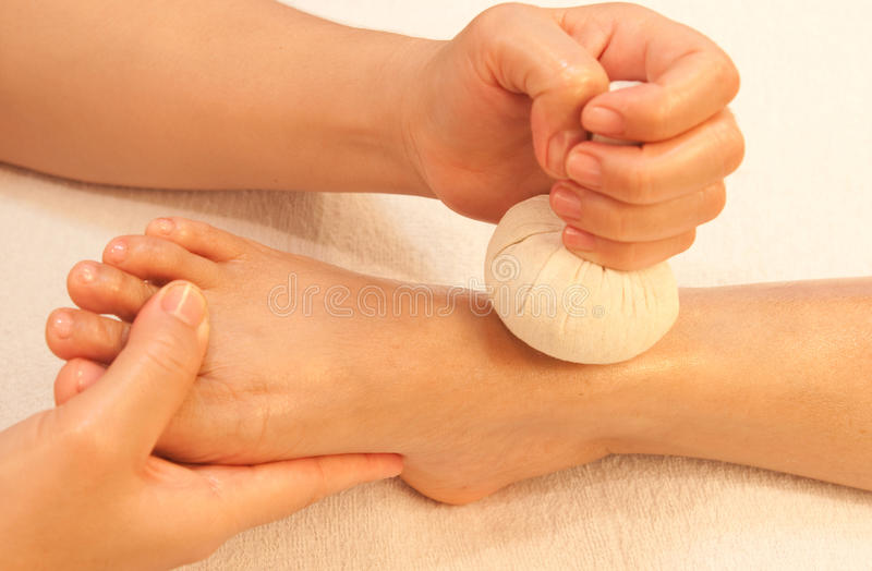 Reflexology foot massage by ball herb royalty free stock photos