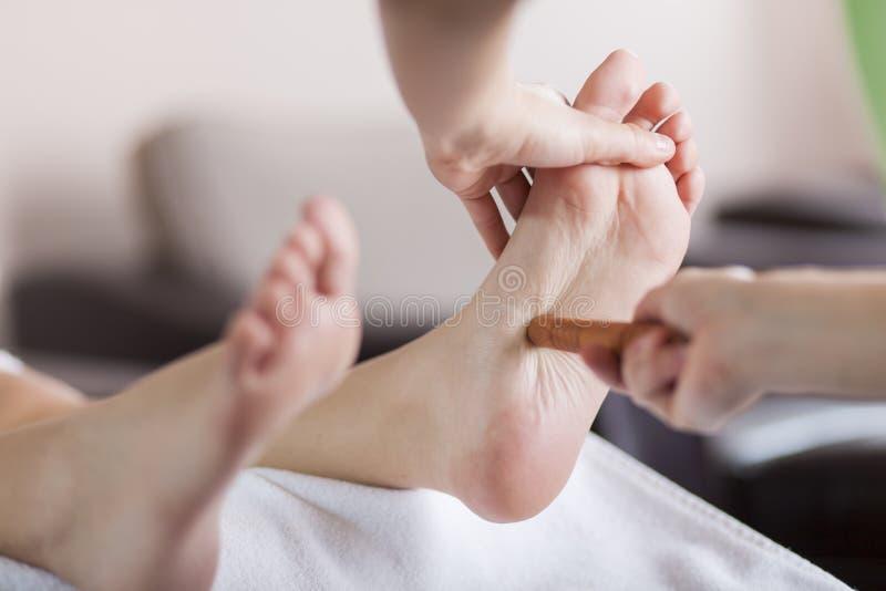 Reflexology foot massage. Close view of the reflexology foot massage stock photography