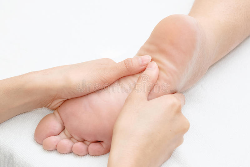 Reflexology foot massage. In the day spa royalty free stock photo