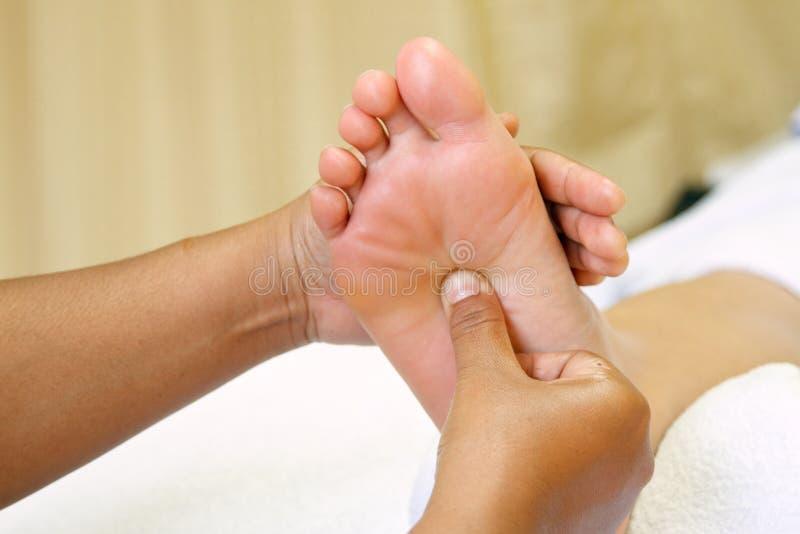 Reflexology foot massage, spa foot stock photos