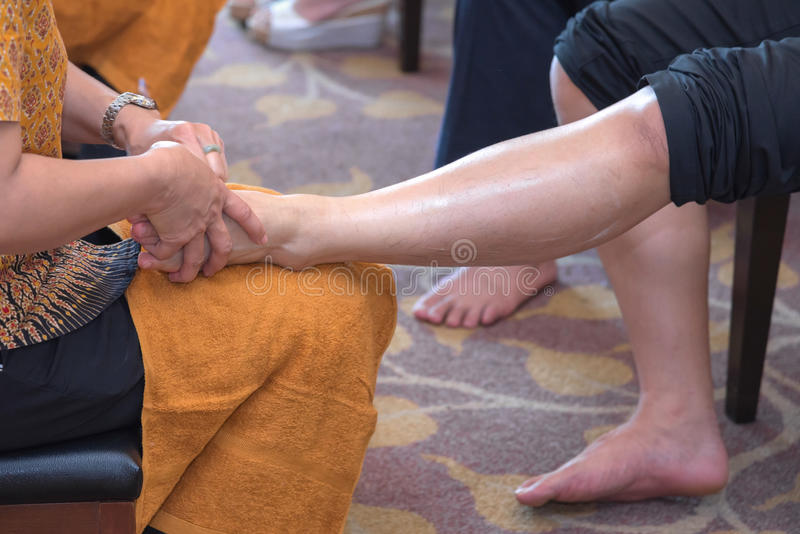 Reflexology foot massage in Thai spa treatment royalty free stock photography