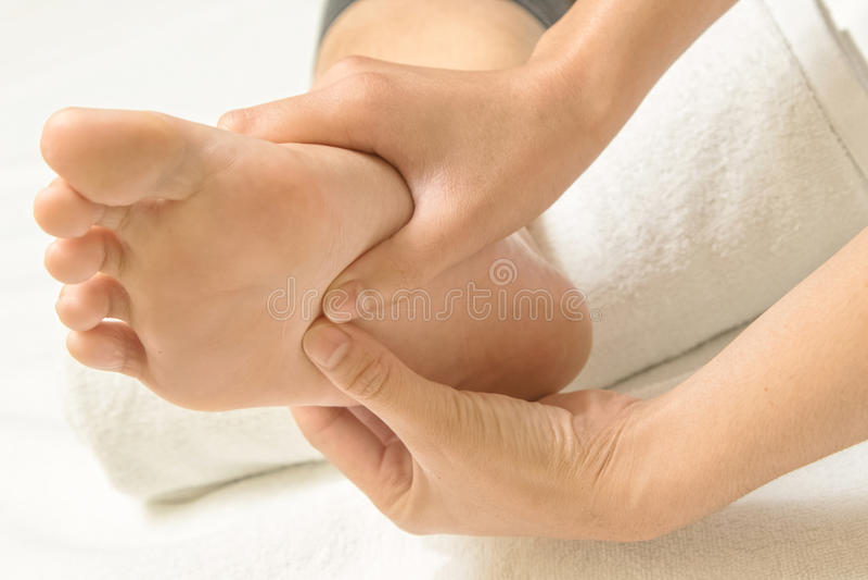 Reflexology foot massage. Thaispa massage royalty free stock photo