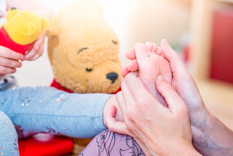 Reflexology foot massage to a female child stock photo