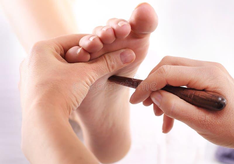 Reflexology. Natural medicine, reflexology, acupressure foot massager oppresses energy flow points stock photo