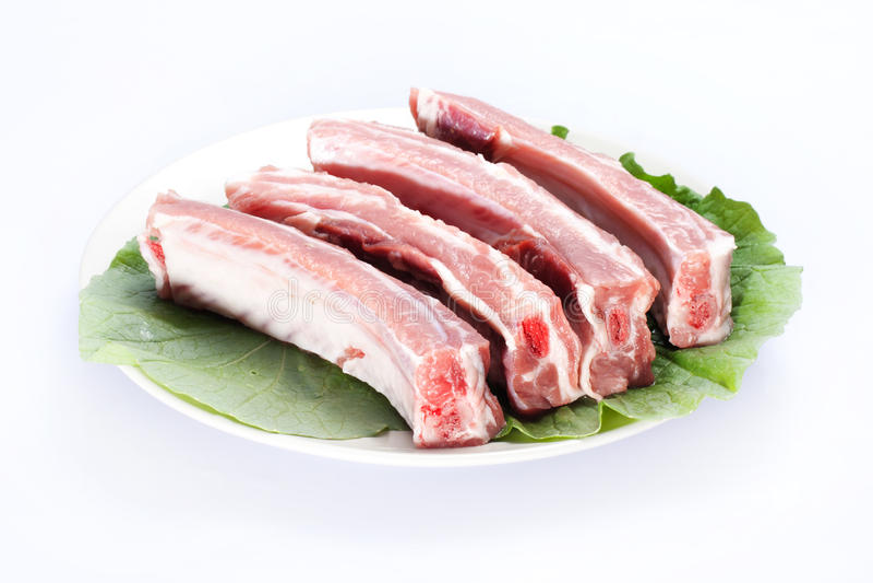 Reforços de carne de porco crus foto de stock royalty free