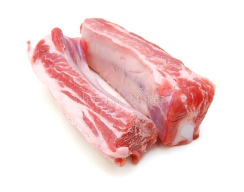 Reforços de carne de porco crus fotos de stock royalty free