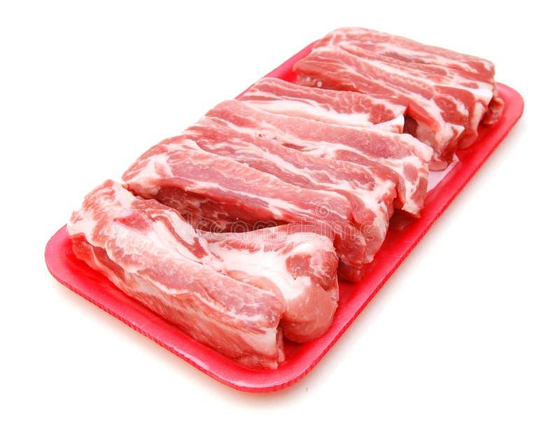 Reforços de carne de porco crus fotos de stock