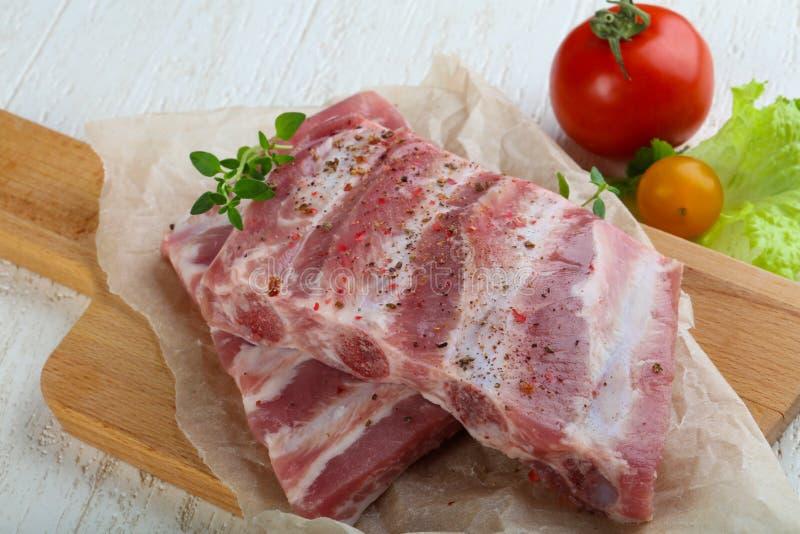 Reforços de carne de porco crus fotografia de stock