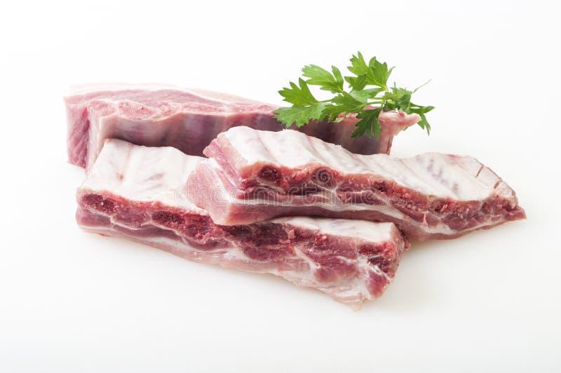 Reforços de carne de porco crus isolados fotografia de stock