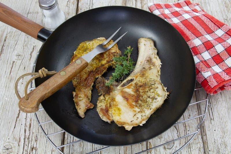 Reforços de carne de porco cozinhados imagem de stock