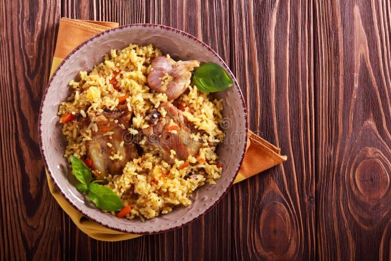 Reforços de carne de porco e prato do arroz imagem de stock royalty free