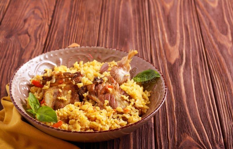 Reforços de carne de porco e prato do arroz foto de stock