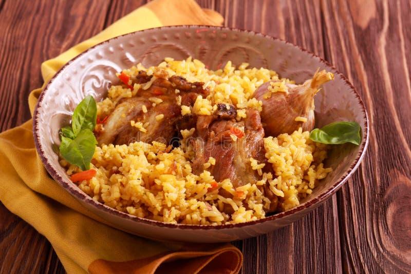 Reforços de carne de porco e prato do arroz fotografia de stock royalty free