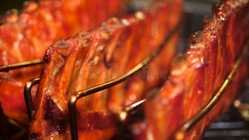 Refor?os de carne de porco grelhados fotografia de stock