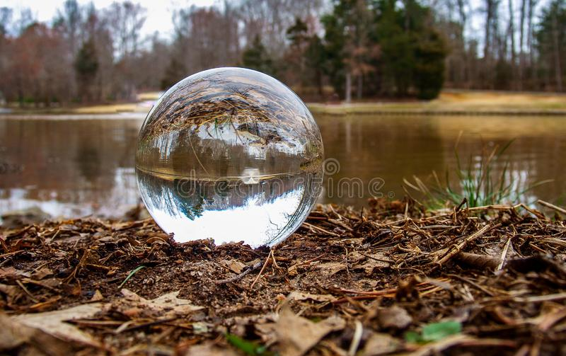 A Crystal Ball Inverts Image of Lake Fountain stock photography
