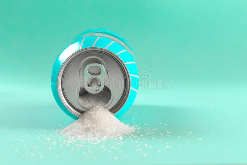 Refresh drink can pouring sugar stream in sweet and calories content of soda and energy drinks concept in unhealthy nutrition and. Diet concept royalty free stock photos